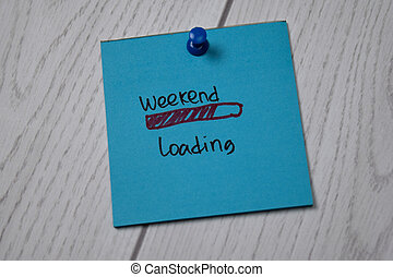 Weekend Loading write on sticky note isolated on wooden table.