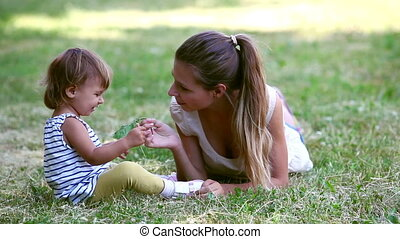 Weekend outdoors - Playful mom and her child enjoying their...