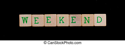 Weekend spelled out in old wooden blocks