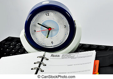 Weekly Planner Note, keyboar and clock with white background
