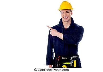weg, de arbeider van de bouw, wijzende