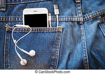weißes, smartphone, in, dein, tasche, blaue jeans, mit, kopfhörer, und, usb kabel, für, übertragung, daten, oder, information., kopieren platz, hintergrund