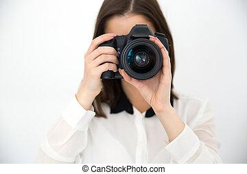 weibliche , fotograf, mit, fotoapperat, aus, grauer hintergrund