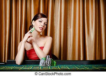 weibliche , spieler, sitzen, an, der, roulett tisch
