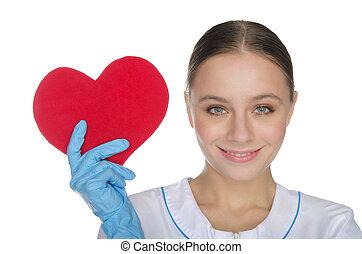 weiblicher doktor, in, handschuhe, shows, a, herz, symbol