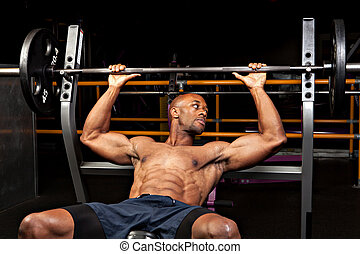 Weigh Bench Press - Weight lifter at the bench press about...