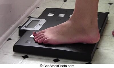 Weighing on Talking Scale - Feet stepping on scale and...
