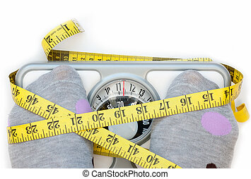 Weighing scales - Closeup of a measuring tape wrapped aroudn...