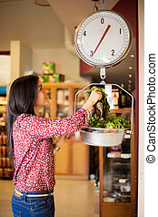 Weighing some vegetables