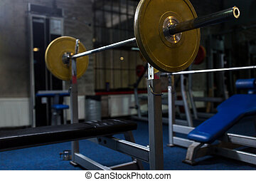 weight bench with barbell in gym - sport, fitness and...