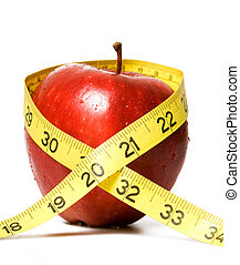Weight loss - apple and yellow tape on isolated white