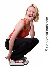 Weight loss - Attractive blond woman squatting down on a ...