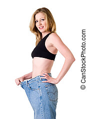 Weight loss - Attractive slim blond woman demonstrating...