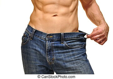 Weight loss - Closeup of sexy male abs and waist in jeans on...