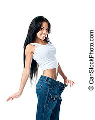 Weight loss - Woman demonstrating weight loss by wearing an...