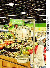 Weight scale - A weight scale in a produce section of a ...