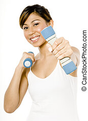 Weight Training - A young woman exercising with small ...