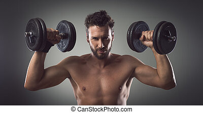 Weight training - Confident attractive young man working out...