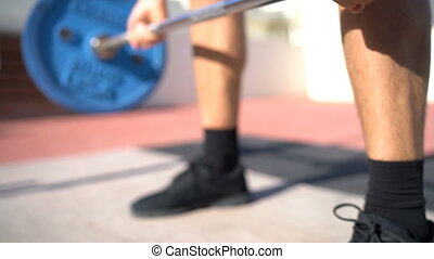 Weightlifting deadlift deadlift exercise. Fitness man bodybuilding or powerlifting at outdoor gym. Close up of hands.