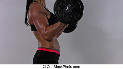 Weightlifting havy barbells - Muscular woman is lifting ...