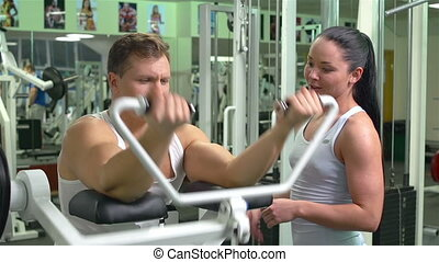 Weightlifting - Strong athlete lifting weights in the gym...