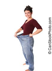 Weightloss - Pretty brunette holding out her old jeans who...