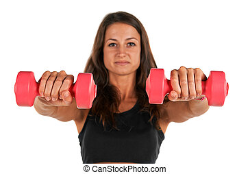 Weights in the hands of a young woman