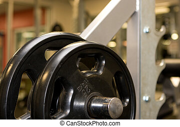 Weights on a rack in the fitness room.