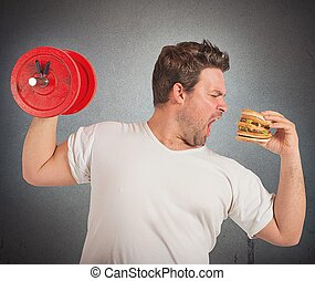 Weights vs sandwich - Fat man lifts weights eating a ...