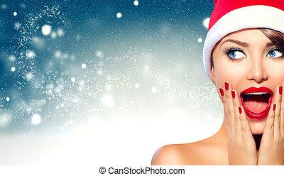 weihnachten., schöne , überrascht, frau, in, santa, hut