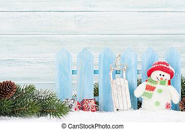 weihnachtsgeschenk, kästen, schneemann, spielzeug, und, tanne, zweig