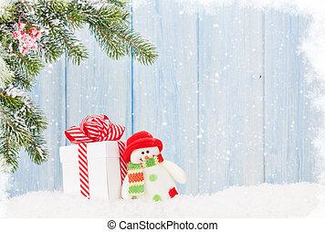 weihnachtsgeschenk, kasten, schneemann, spielzeug, und, tanne, zweig