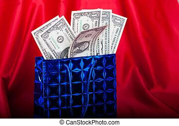 weihnachtsgeschenk, mit, dollar, auf, roter hintergrund