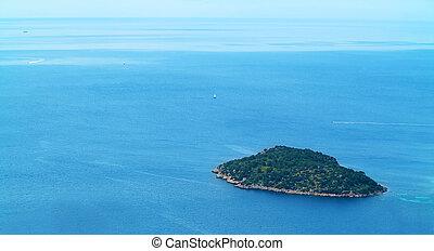 weinig; niet zo(veel), eiland, gezien, van boven