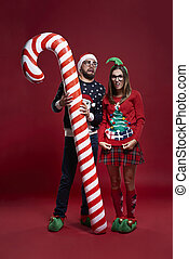 Weird Christmas couple with candy cane