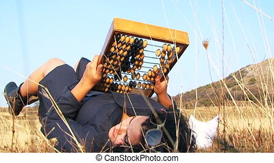Weird Woman In Black  With Abacus At Nature
