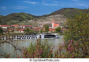 Weissenkirchen village with boat on Danube river in Wachau, Austria