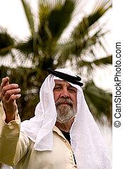 Welcome - A man wearing an Arabic style of headdress,...