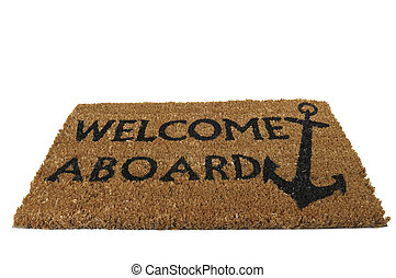 A classic welcome aboard mat with anchor, at tilted angle.