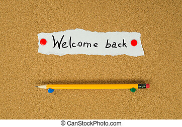 Welcome back text note message pin on bulletin board