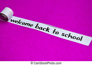 Welcome Back To school text, Inspiration, Motivation and business concept on purple torn paper