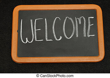 Welcome - Blackboard with the word welcome written on it