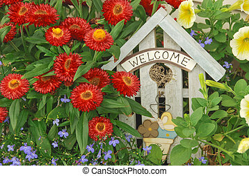 Welcome Garden - A sign welcoming guests to a a floral...