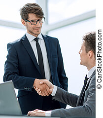 welcome handshake business colleagues in the office