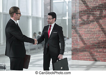 welcome handshake business people in the office