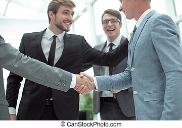 welcome handshake of business people in the office