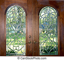 Arched double doors with beleveled glass to welcome anyone home.