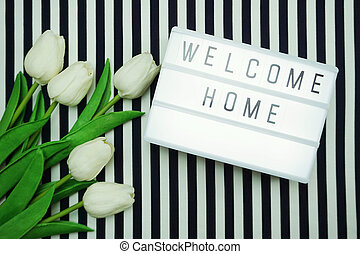 Welcome Home Light box letters Top view Flat Lay with tulip ...