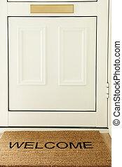 Welcome Mat In Front Of Door To Home