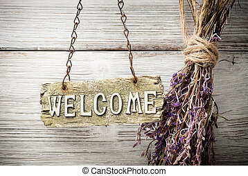 Welcome. - On the wood background of a plaque with an ...